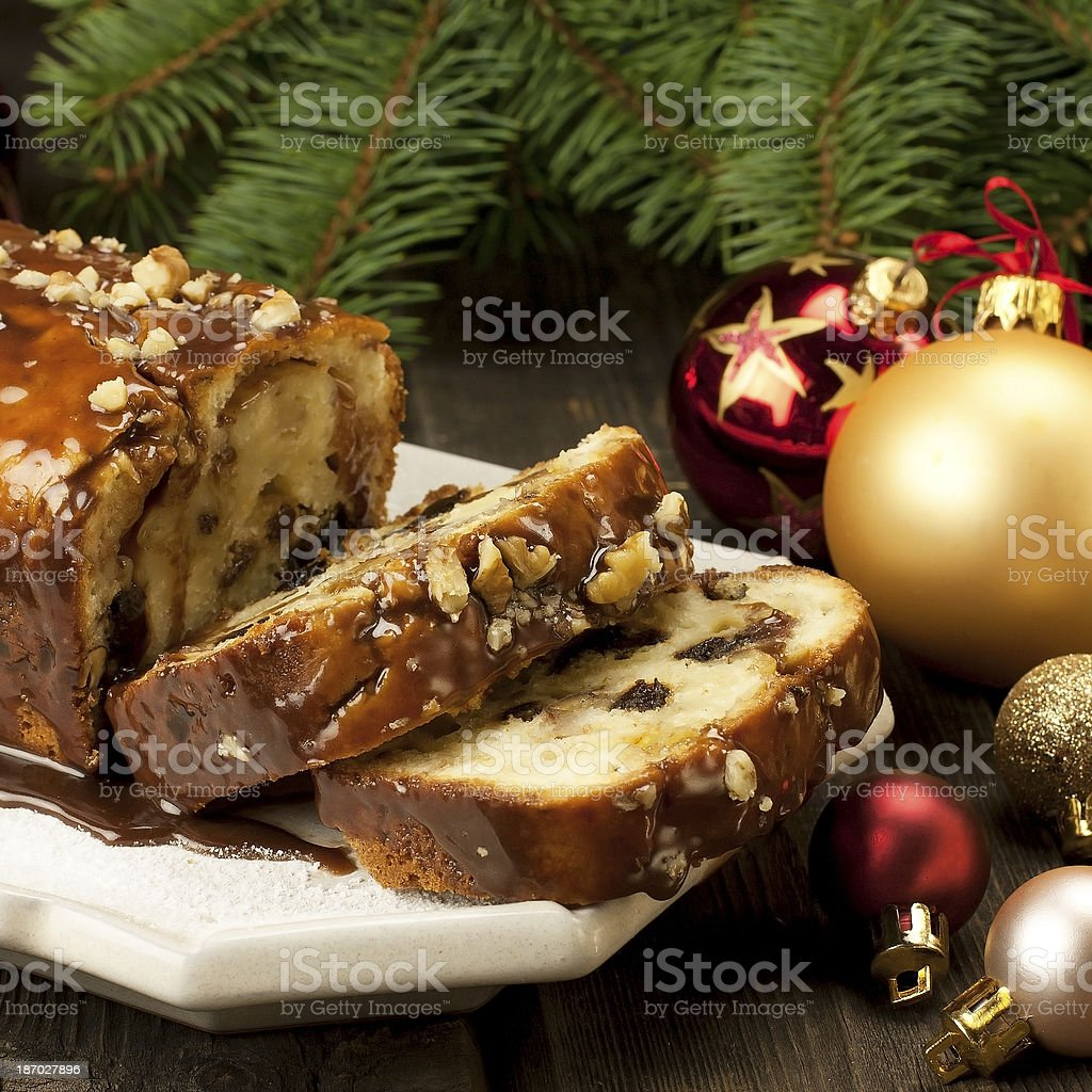 Slice of Christmas cake decorated with walnuts stock photo