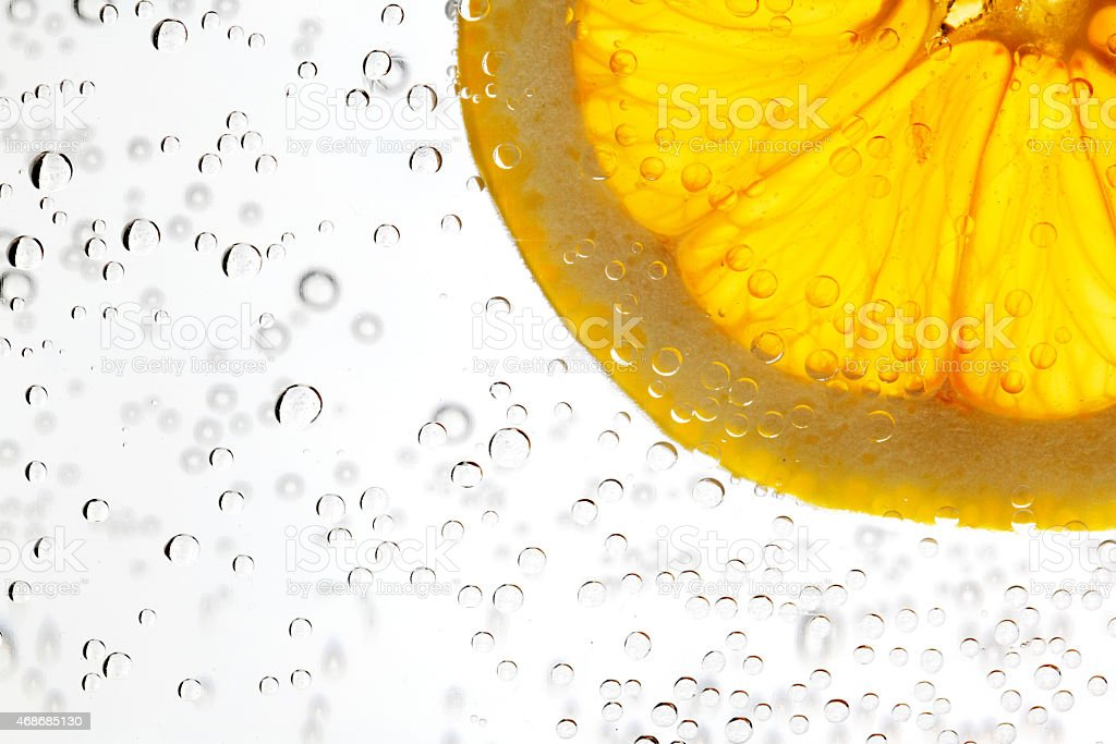 A slice of citrus orange in a glass of water stock photo