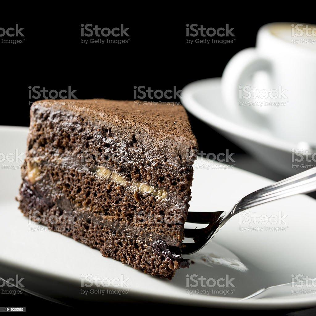Slice of delicious chocolate cake stock photo