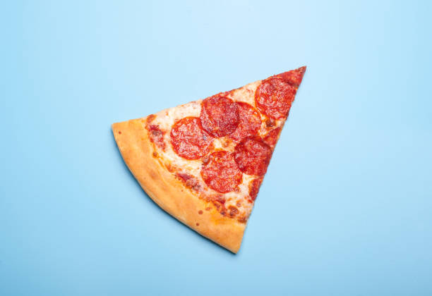 slice of delicious pizza pepperoni stock photo