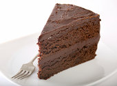 Chocolate cake on a plate. Grey stone background. Copy space. Top view