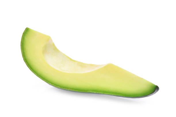 slice of fresh avocado isolated on white background stock photo
