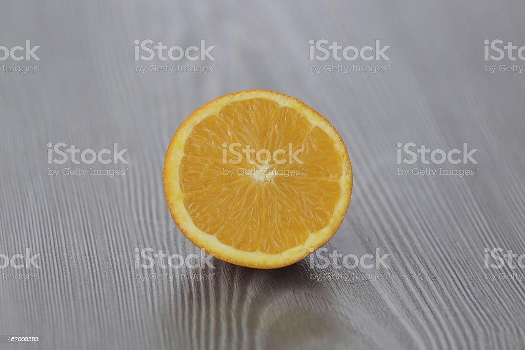 Slice of fresh orange on wood stock photo