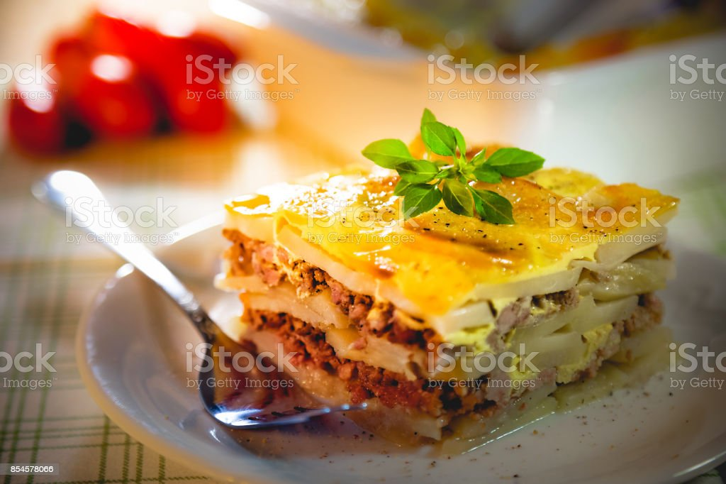 Slice of freshly cooked Serbian moussaka meal on white plate stock photo