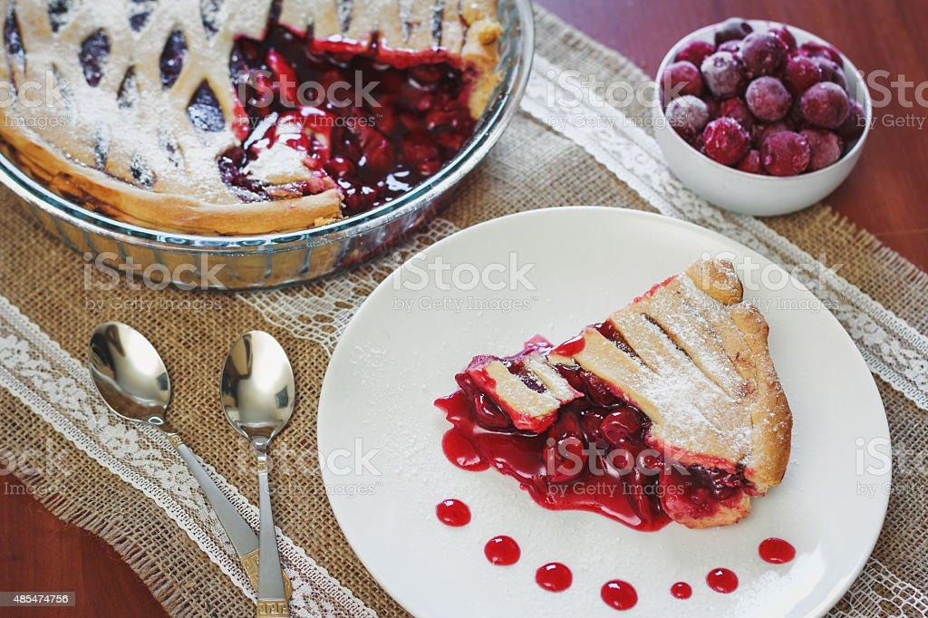 Slice of friut pie with cherries stock photo