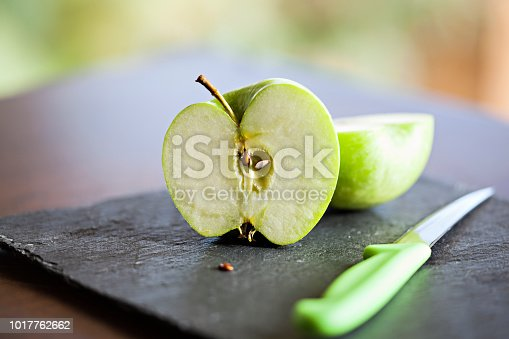 Slice of Green apples on black slate