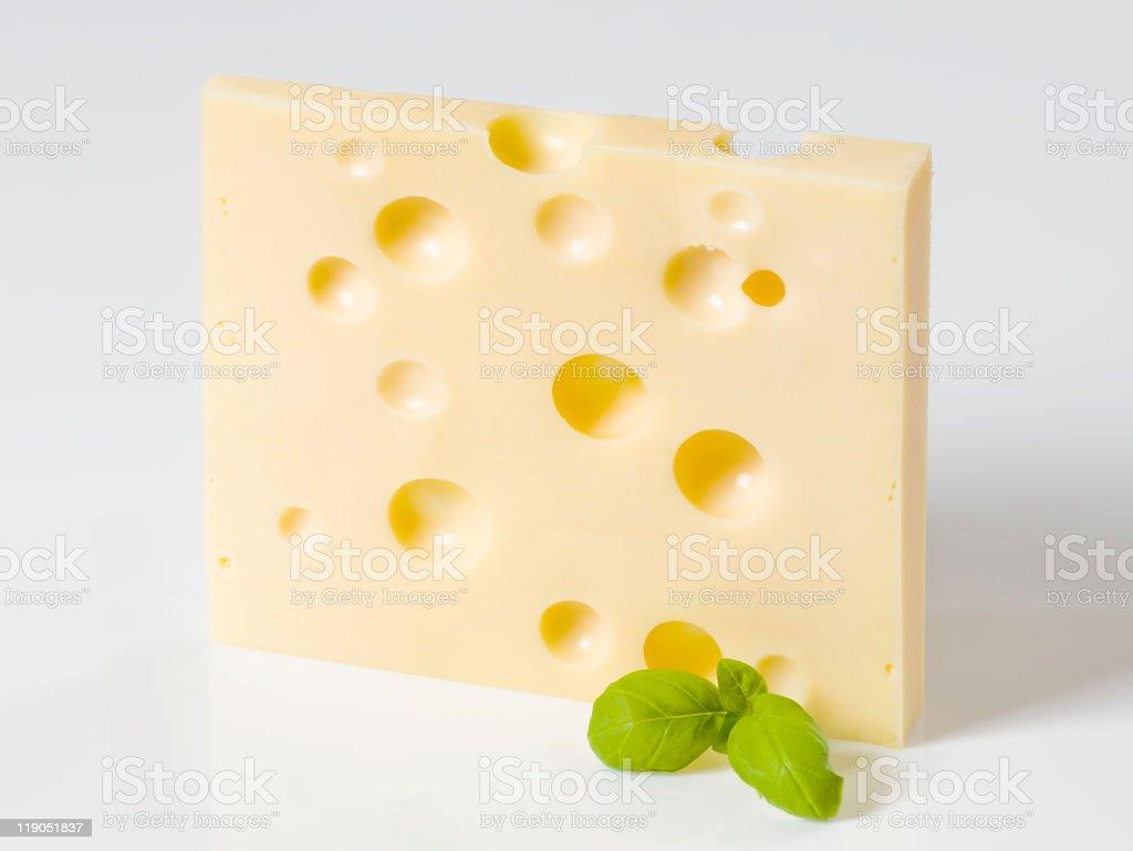 Slice of hard cheese stock photo