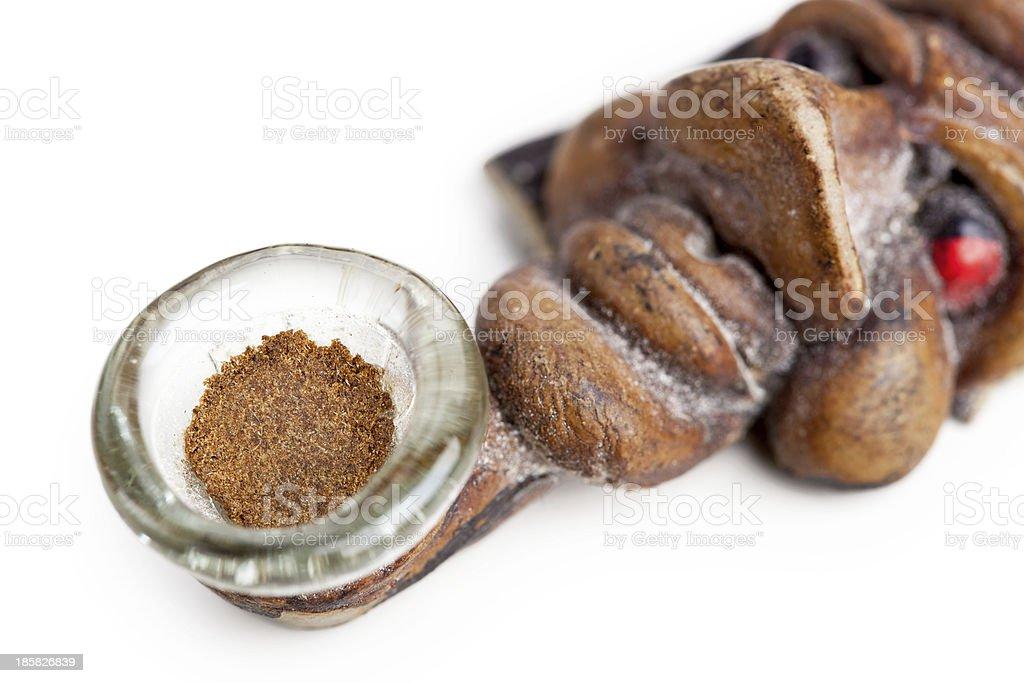 Slice of hashish in smoking pipe stock photo