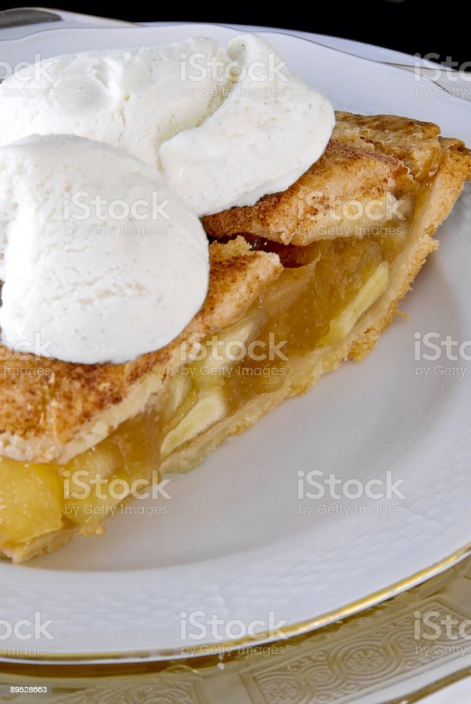 Slice of homemade apple pie with vanilla ice cream scoops royalty-free stock photo