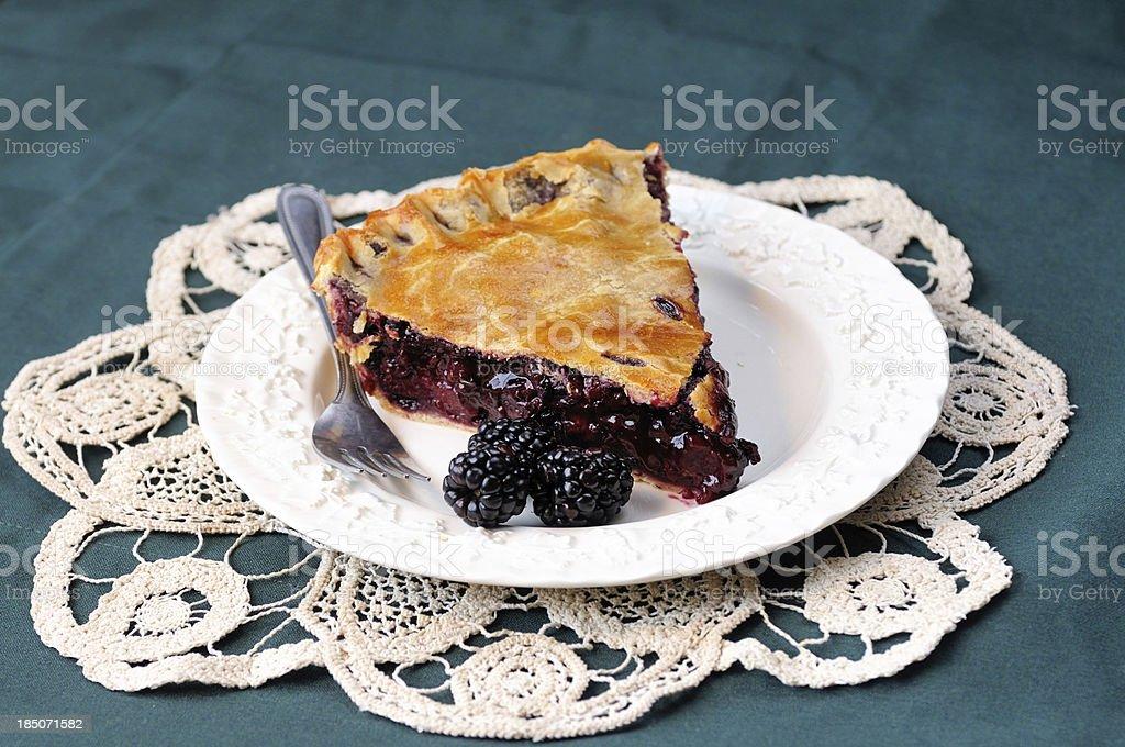 Slice of Homemade Blackberry Pie stock photo