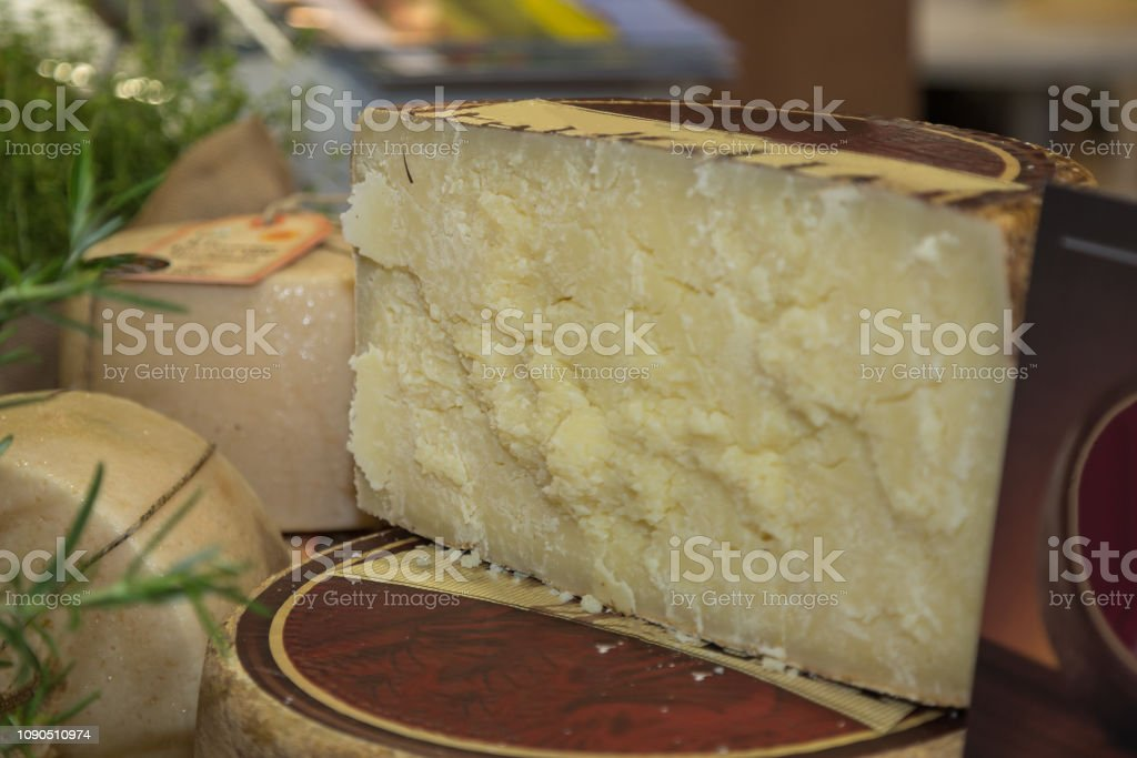 Slice of Italian Sheep's Cheese in a Market stock photo