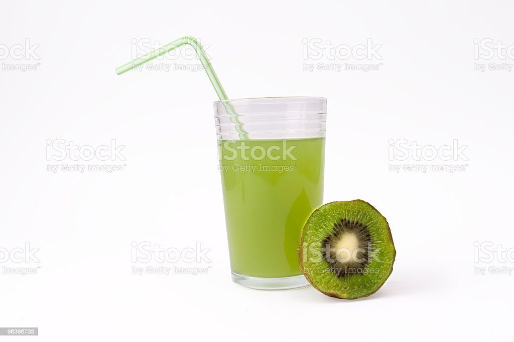 Slice of kiwi and glass   juice with straw - Royalty-free Backgrounds Stock Photo