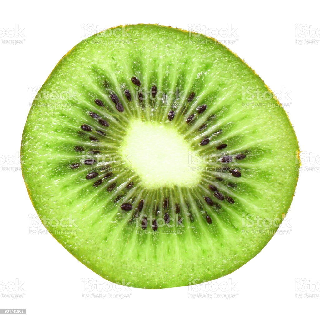 Slice of kiwi fruit isolated on white background. Round slice. Close up. Macro. royalty-free stock photo