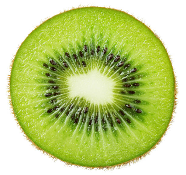 Slice of kiwi fruit isolated on white Slice of kiwi fruit isolated on white background halved stock pictures, royalty-free photos & images