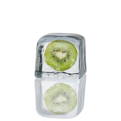 Slice of kiwi inside of dry ice cube isolated on white background