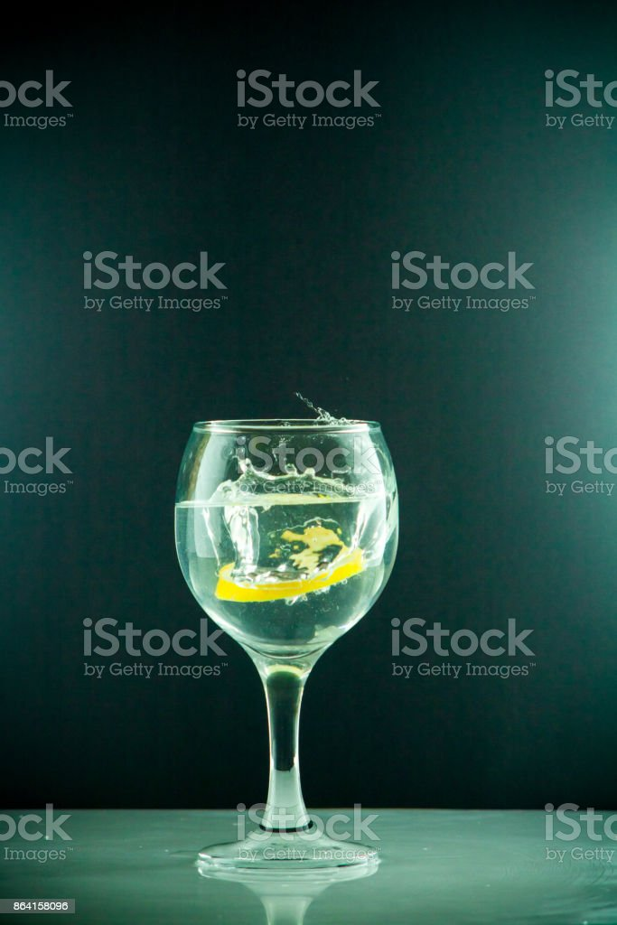slice of lemon drops in a glass of water royalty-free stock photo