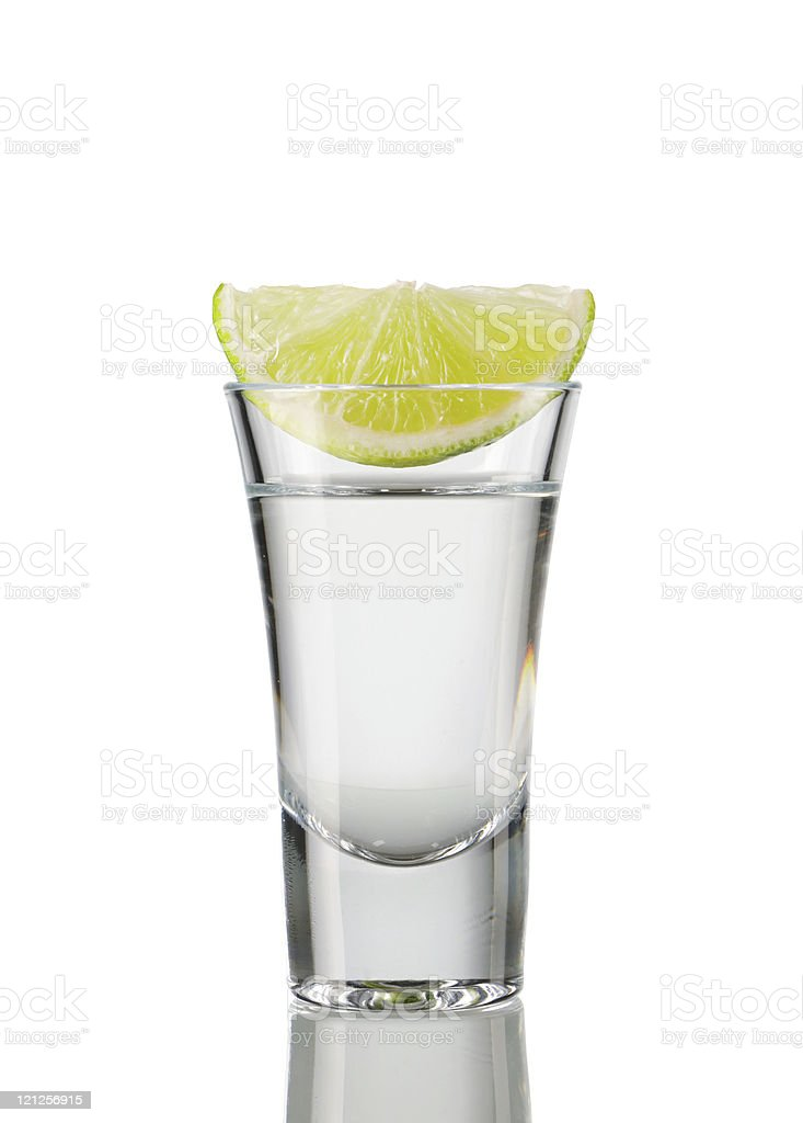 A slice of lemon in a shot of tequila royalty-free stock photo