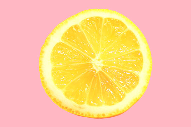 Slice of Lemon Slice of lemon on pink in minimal style limoen stock pictures, royalty-free photos & images