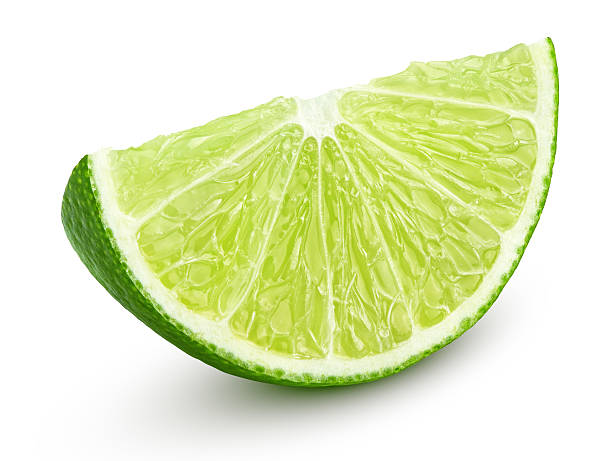 Slice of lime citrus fruit isolated on white Slice of lime citrus fruit isolated on white background with clipping path lime stock pictures, royalty-free photos & images