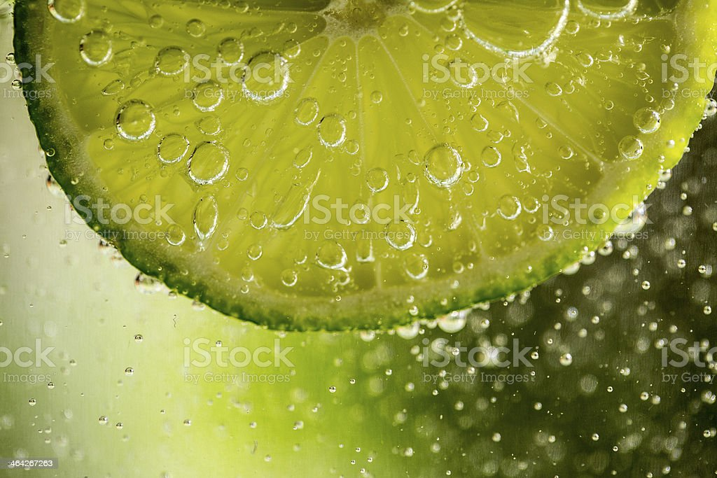 Slice of lime placed inside a bubbly drink stock photo