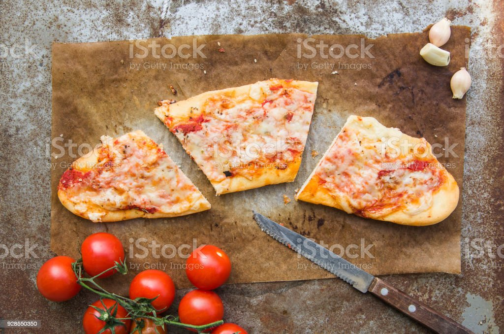 Slice of Margherita pizza on rustic background - foto stock