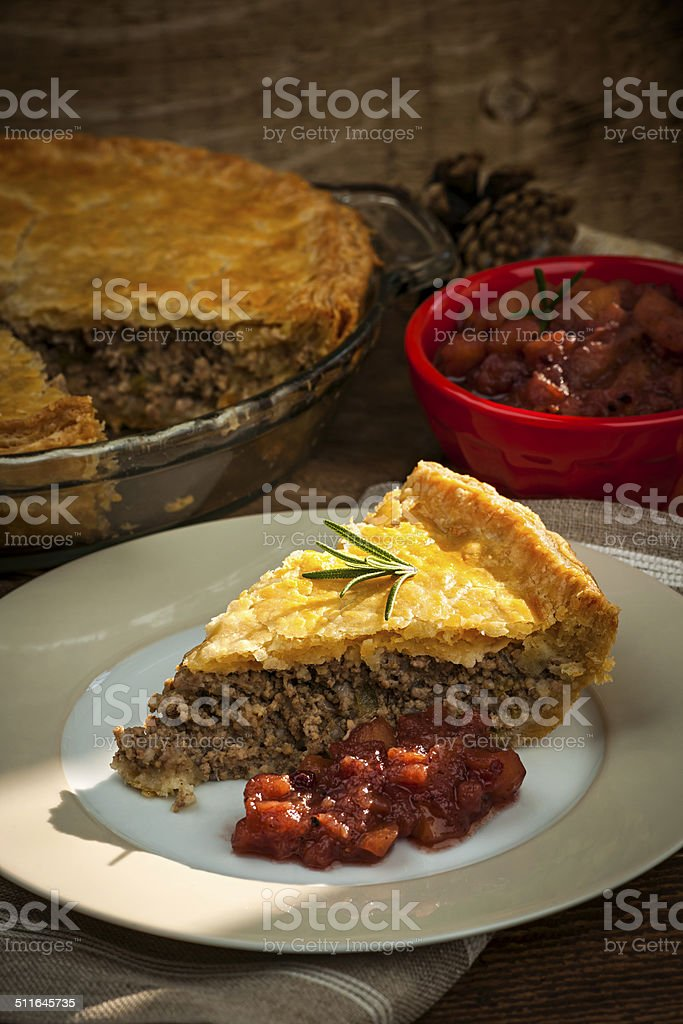 Slice of meat pie Tourtiere stock photo