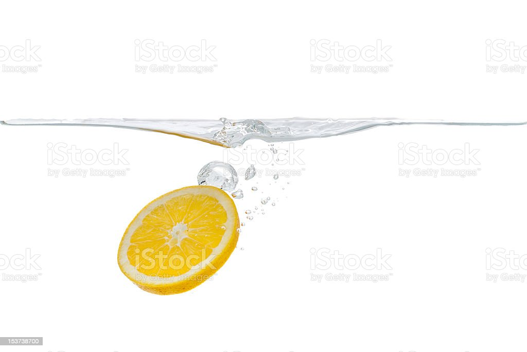 Slice of orange dropped into water royalty-free stock photo