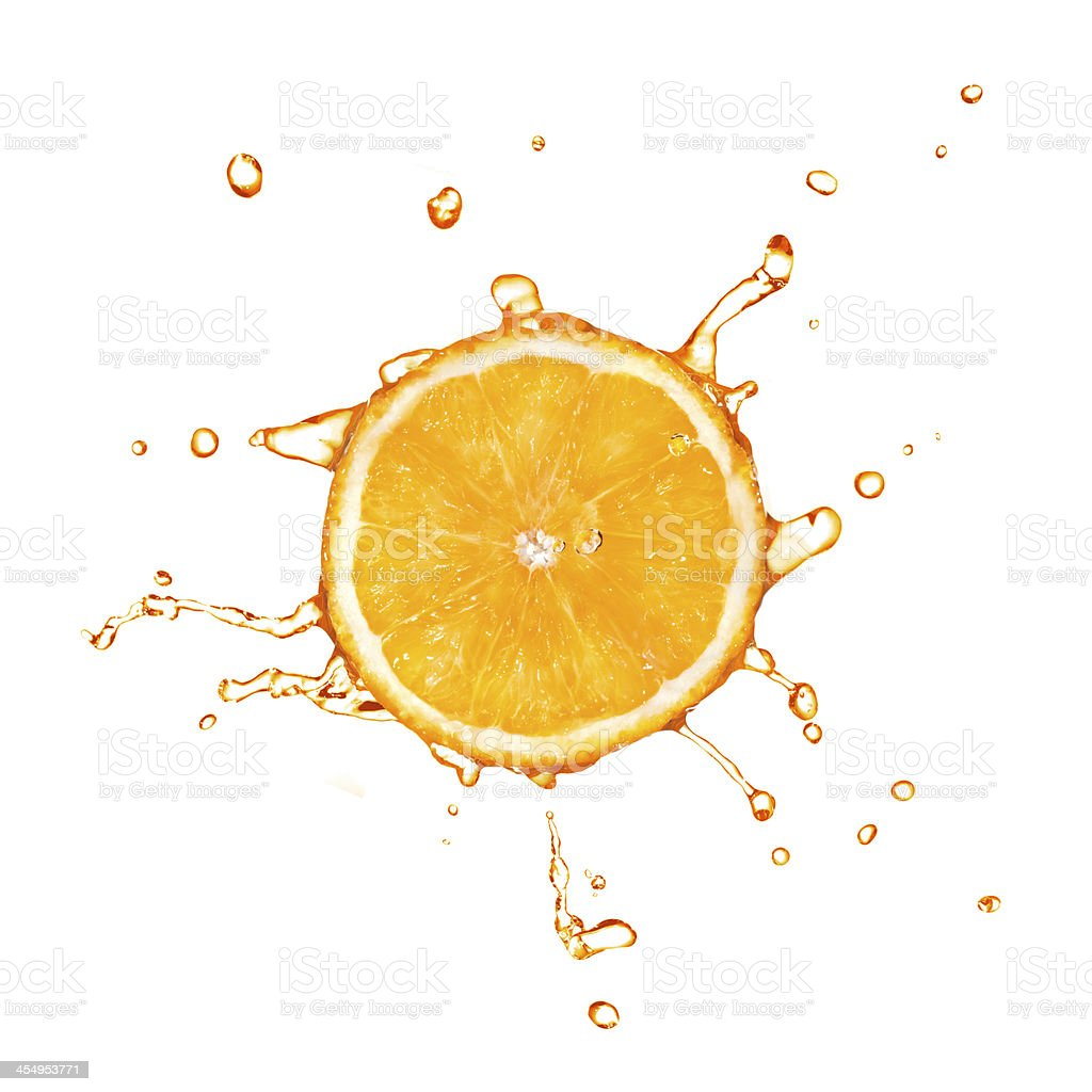 Slice of orange with juice splash isolated on white stock photo