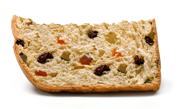 a slice of panettone, with candied fruits and raisins - panettone foto e immagini stock