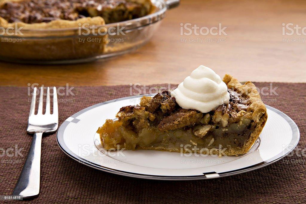 Slice of pecan pie with cream stock photo