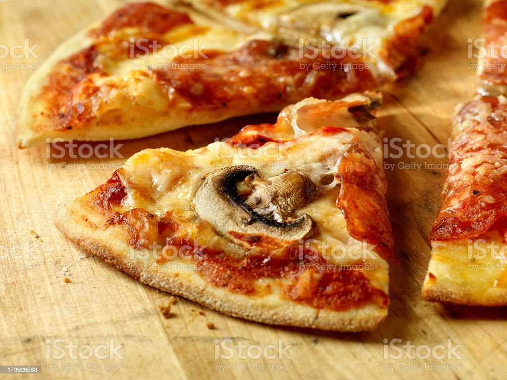 Slice of Pepperoni and Mushroom Pizza royalty-free stock photo