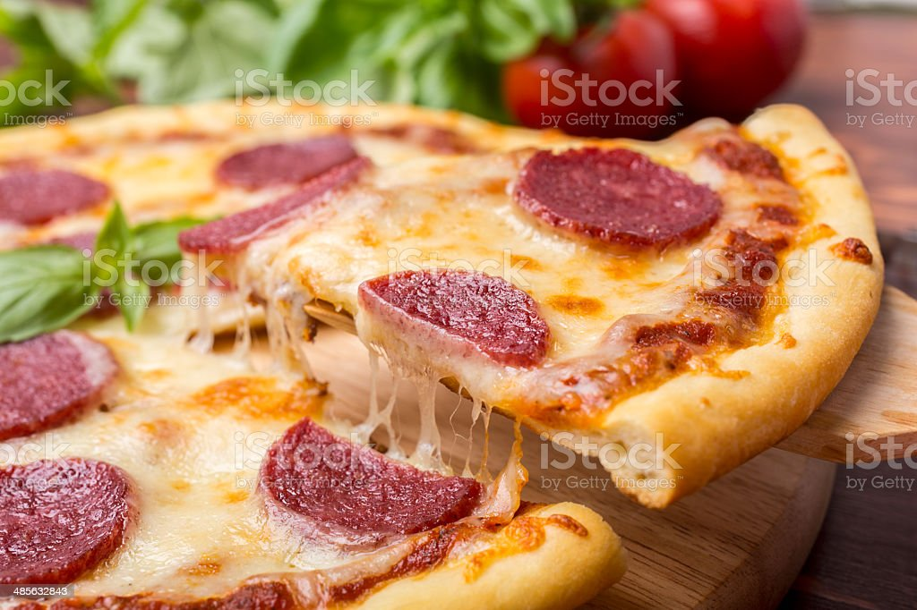 Slice of Pepperoni Pizza stock photo