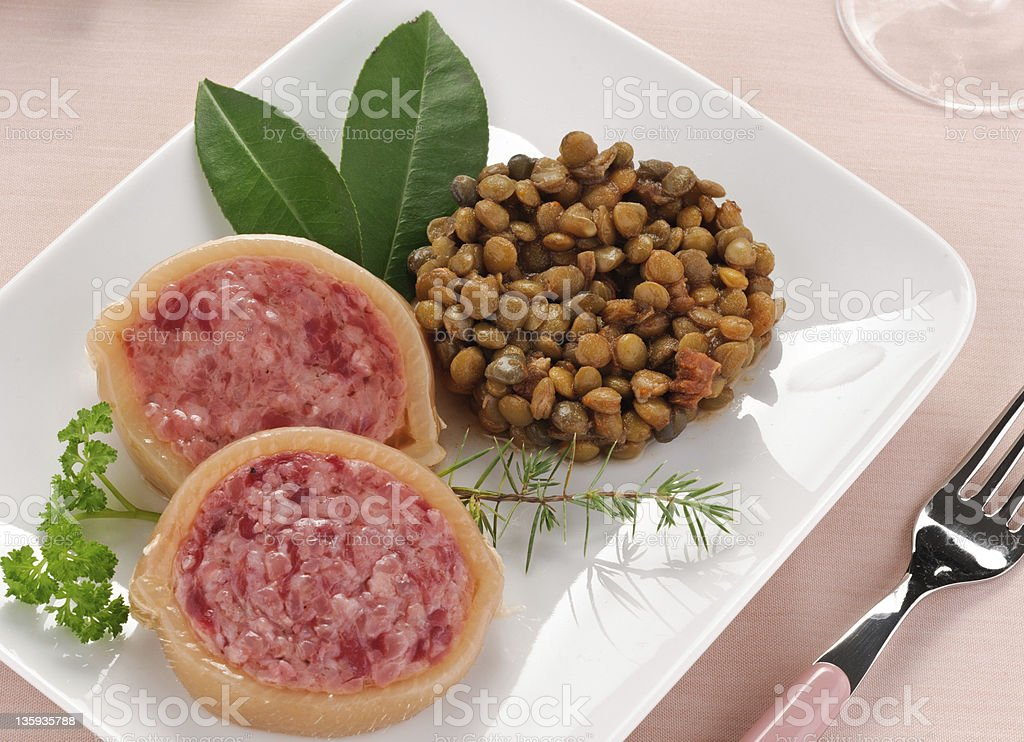 Slice of pig's trotter and lentils stock photo