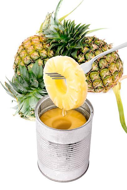 stück ananas auf eine gabelung, isoliert - ananas marmelade stock-fotos und bilder
