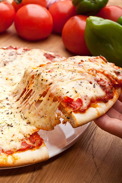 Slice of pizza margarita lifted up stock photo