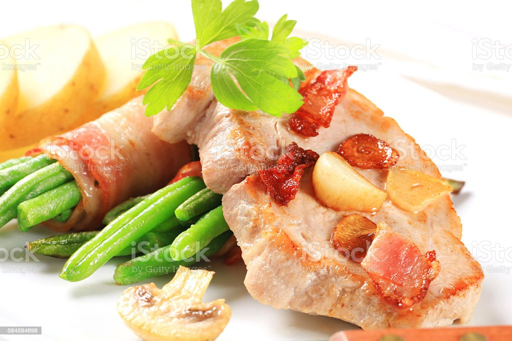 slice of pork with green beans stock photo