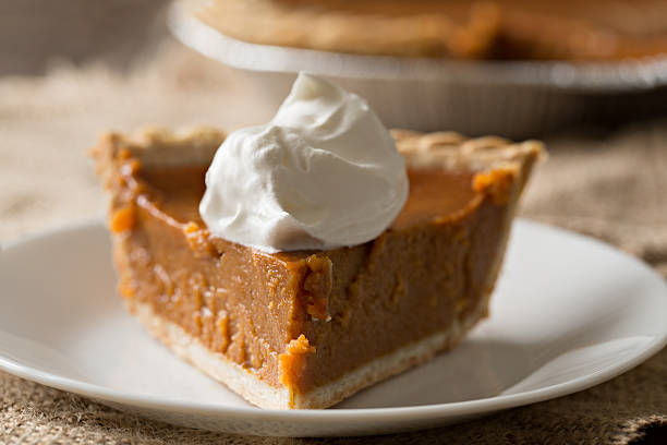 slice of pumpkin pie with cream - pumpkin pie 個照片及圖片檔