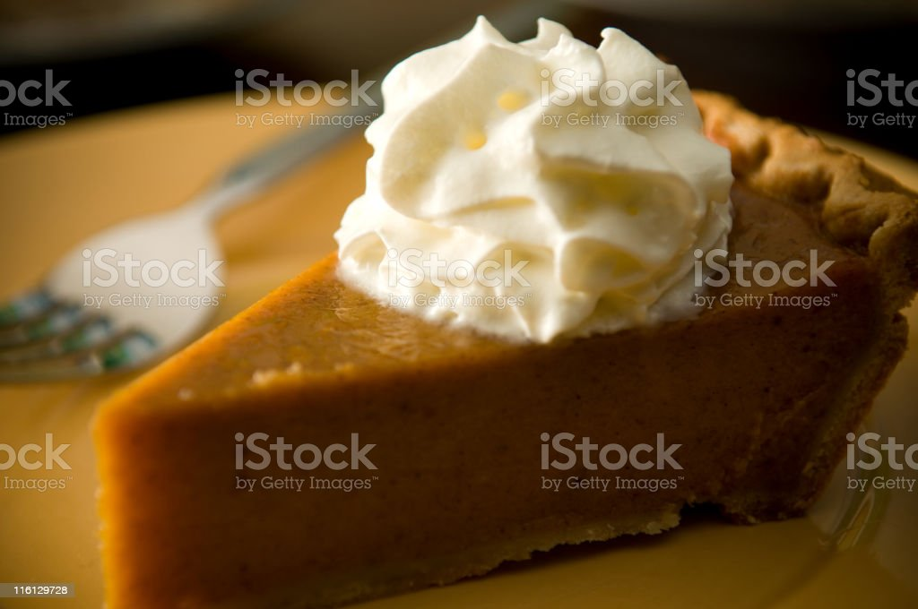 Slice of Pumpkin Pie with Whipped Cream Fork royalty-free stock photo