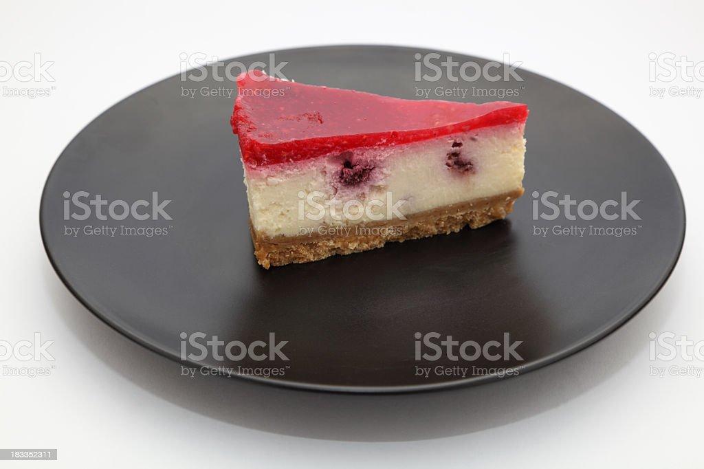 slice of raspberry cheesecake on dark round plate royalty-free stock photo