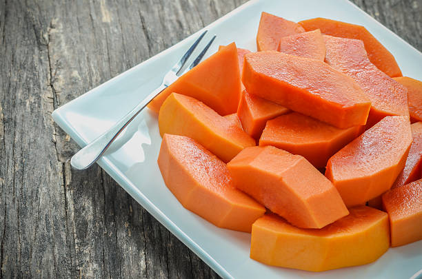 Slice of ripe papayas in white dish stock photo