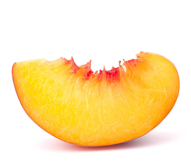 Slice of ripe peach fruit on white background stock photo