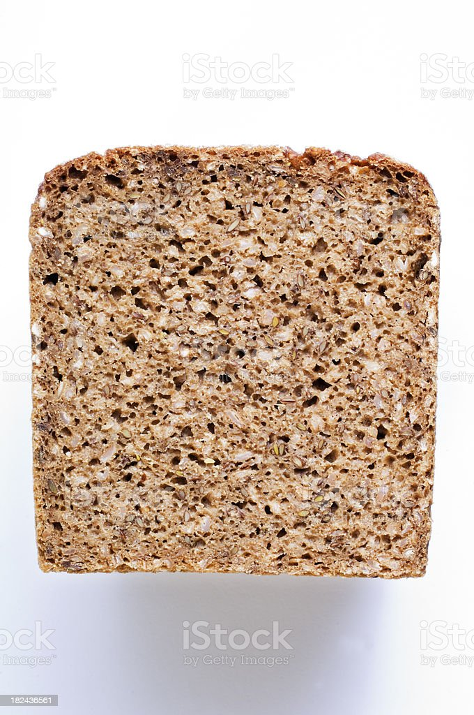 Slice of Rye Bread Isolated Against White Overhead View stock photo