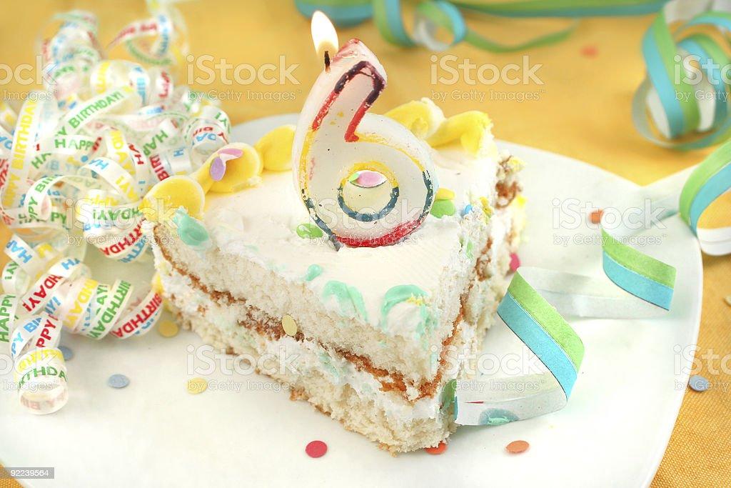 slice of sixth birthday cake stock photo