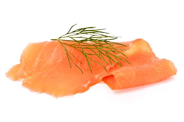 Slice of smoked salmon with a little Rosemary on top
