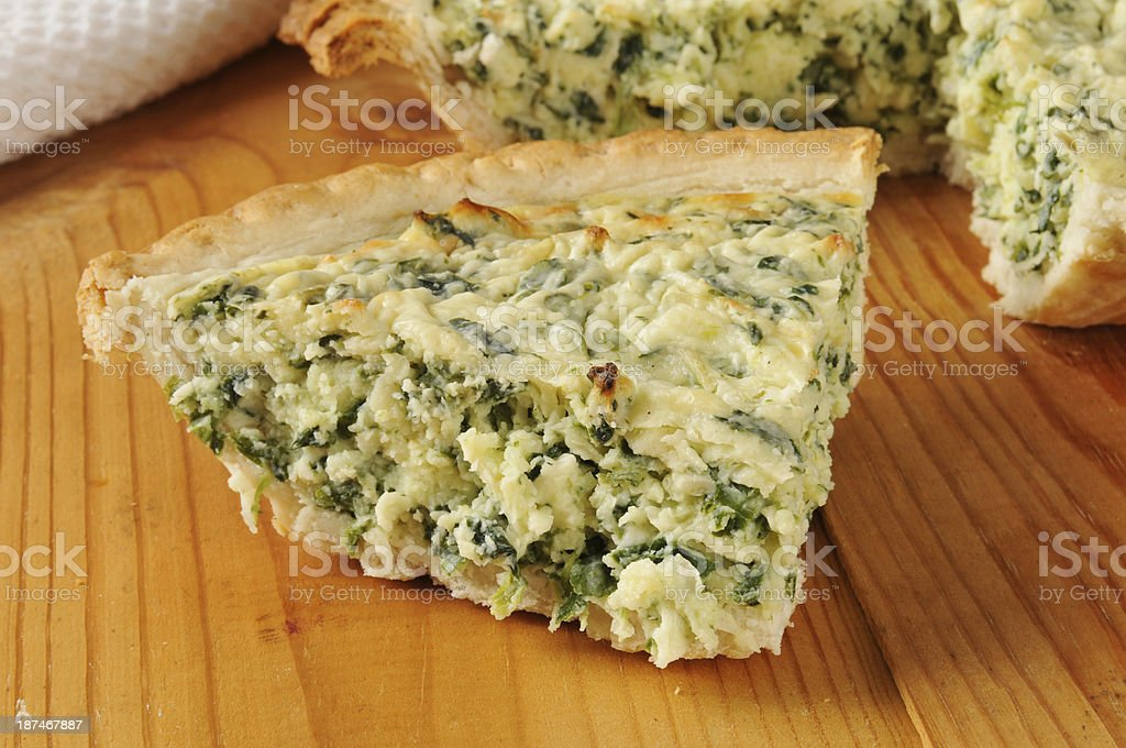 Slice of spinach quiche royalty-free stock photo