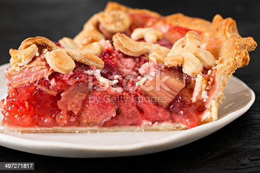 An extreme close up shot of a slice of freshly baked strawberry rhubarb pie.