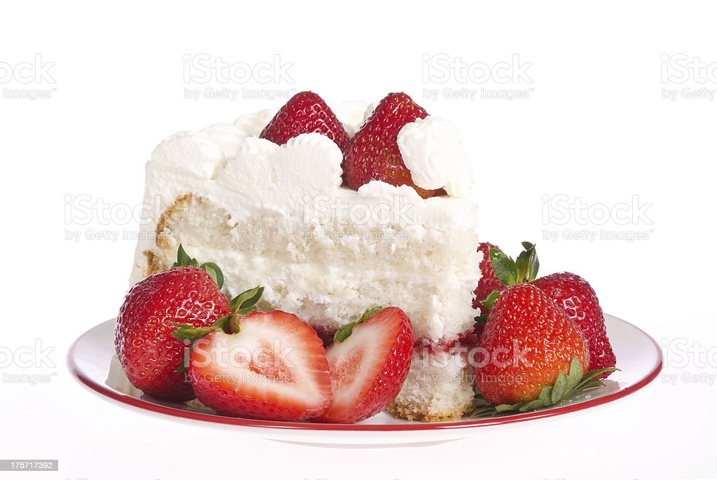Slice of strawberry whipped cream cake stock photo