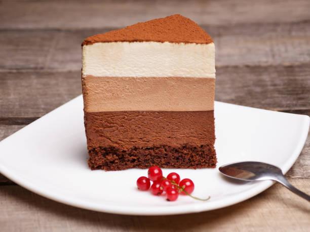 slice of the three chocolate mousse cake stock photo