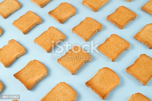istock Slice of Toasted Bread on Blue Background 855153902
