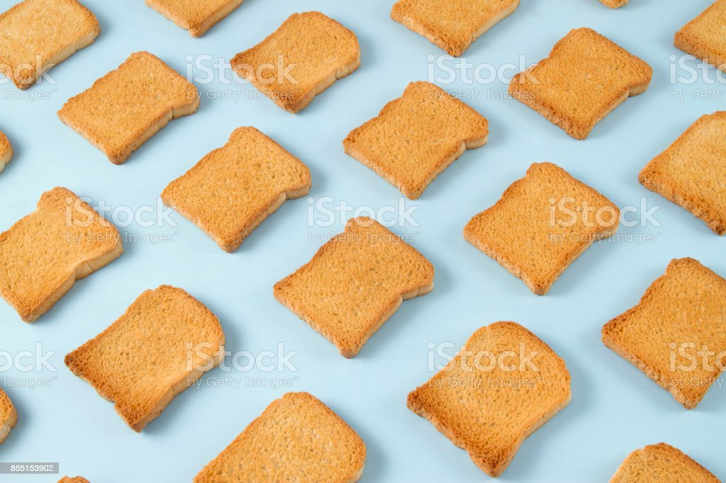 Slice of Toasted Bread on Blue Background stock photo